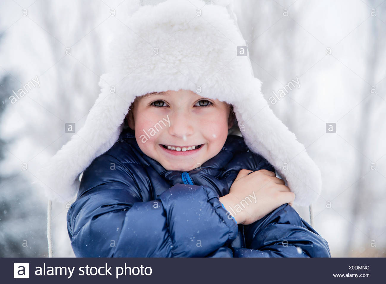 Portrait of boy (6-7) in fur hat - Stock Image