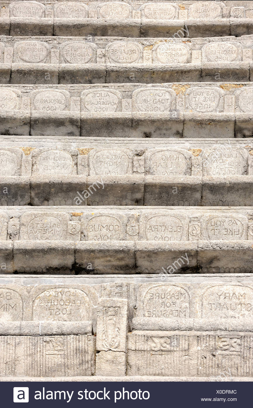 Spectator seats with sculpted backrests in the Minack Theatre, amphitheater at Porthcurno, south coast of Cornwall, England, UK - Stock Image