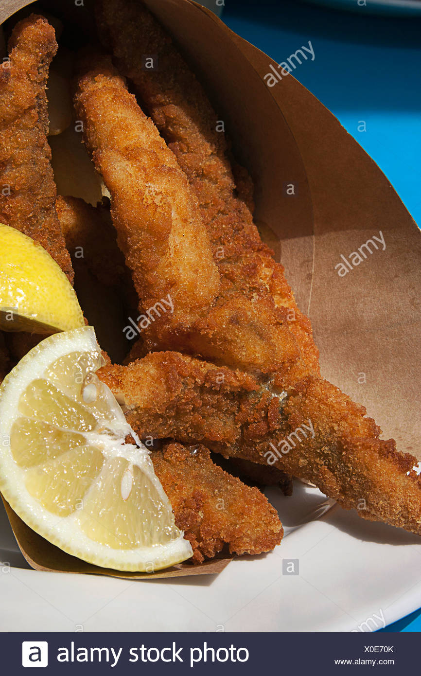 Australia, Tasmania, Hobart, Franklin Wharf, fish and chips wrapped in brown paper - Stock Image