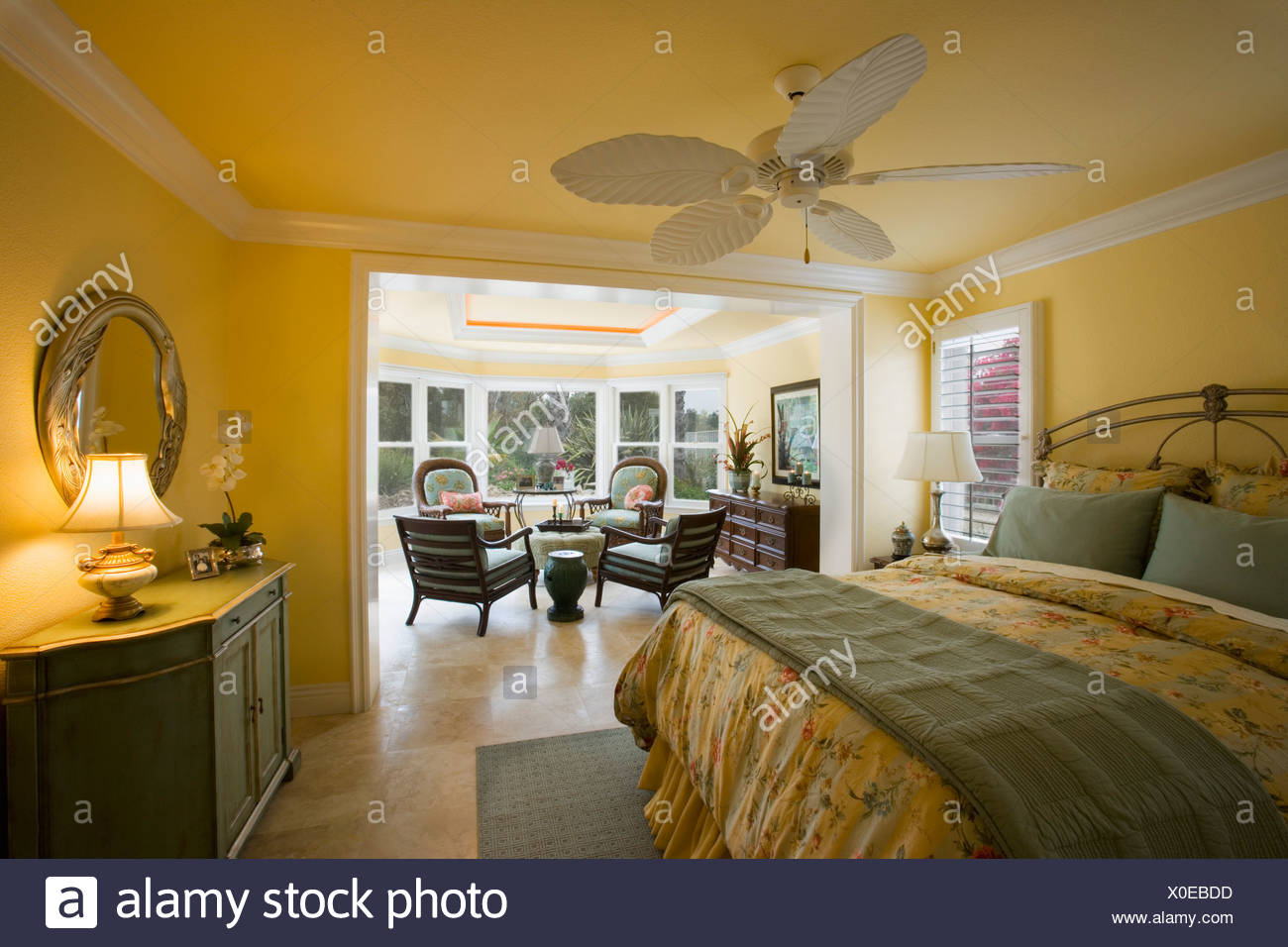 Large Yellow Master Bedroom With Sunroom Stock Photo 275682217 Alamy