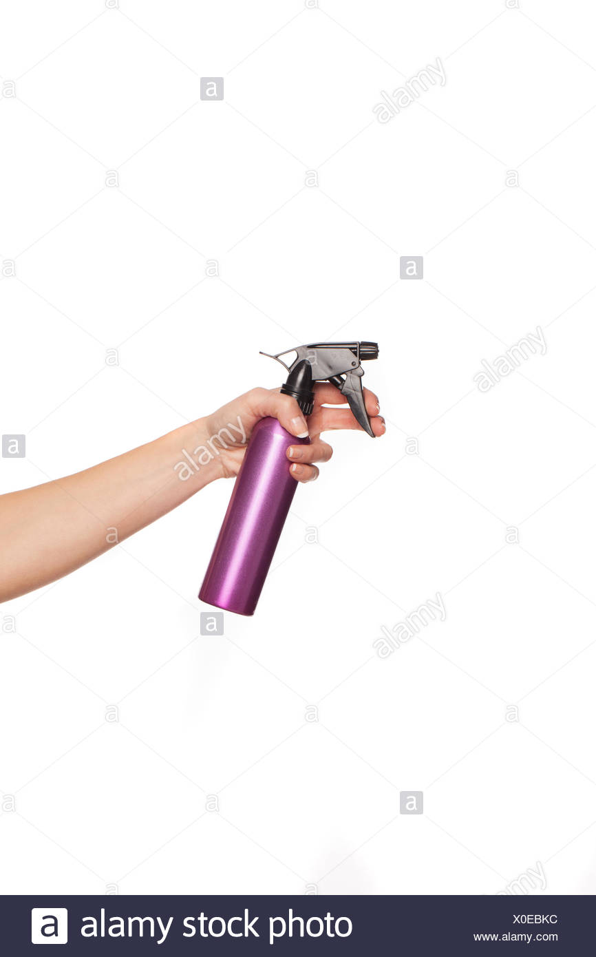 Female hand holding a spray can - Stock Image