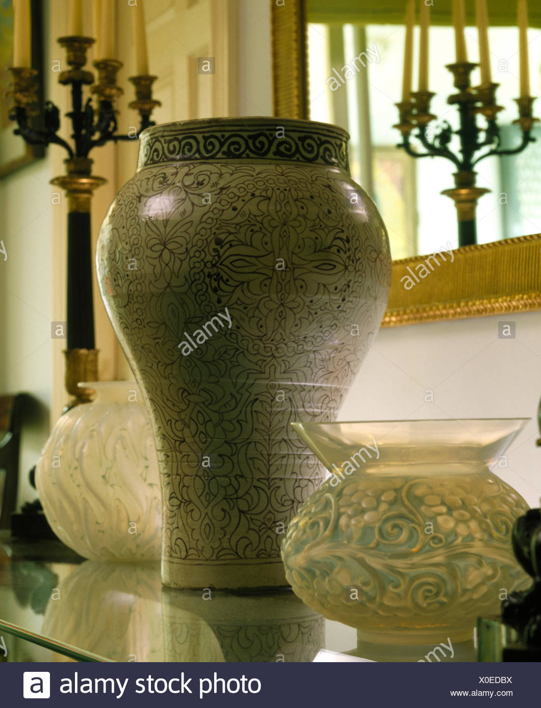 Tall ceramic pot with Art Nouveau glass vases - Stock Image