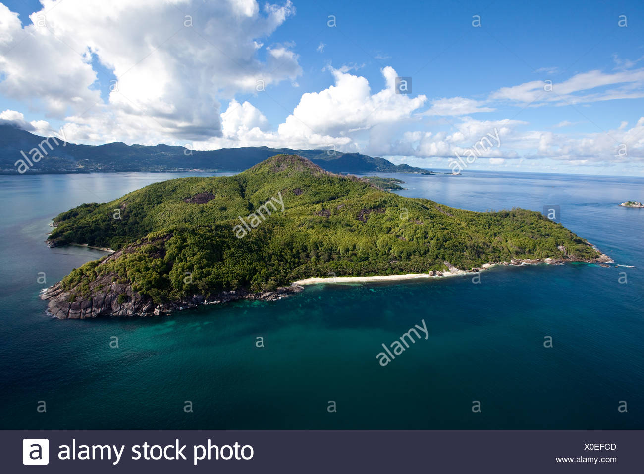 The island Ile Moyenne, in the back the island of Mahe, Seychelles, Indian Ocean, Africa - Stock Image