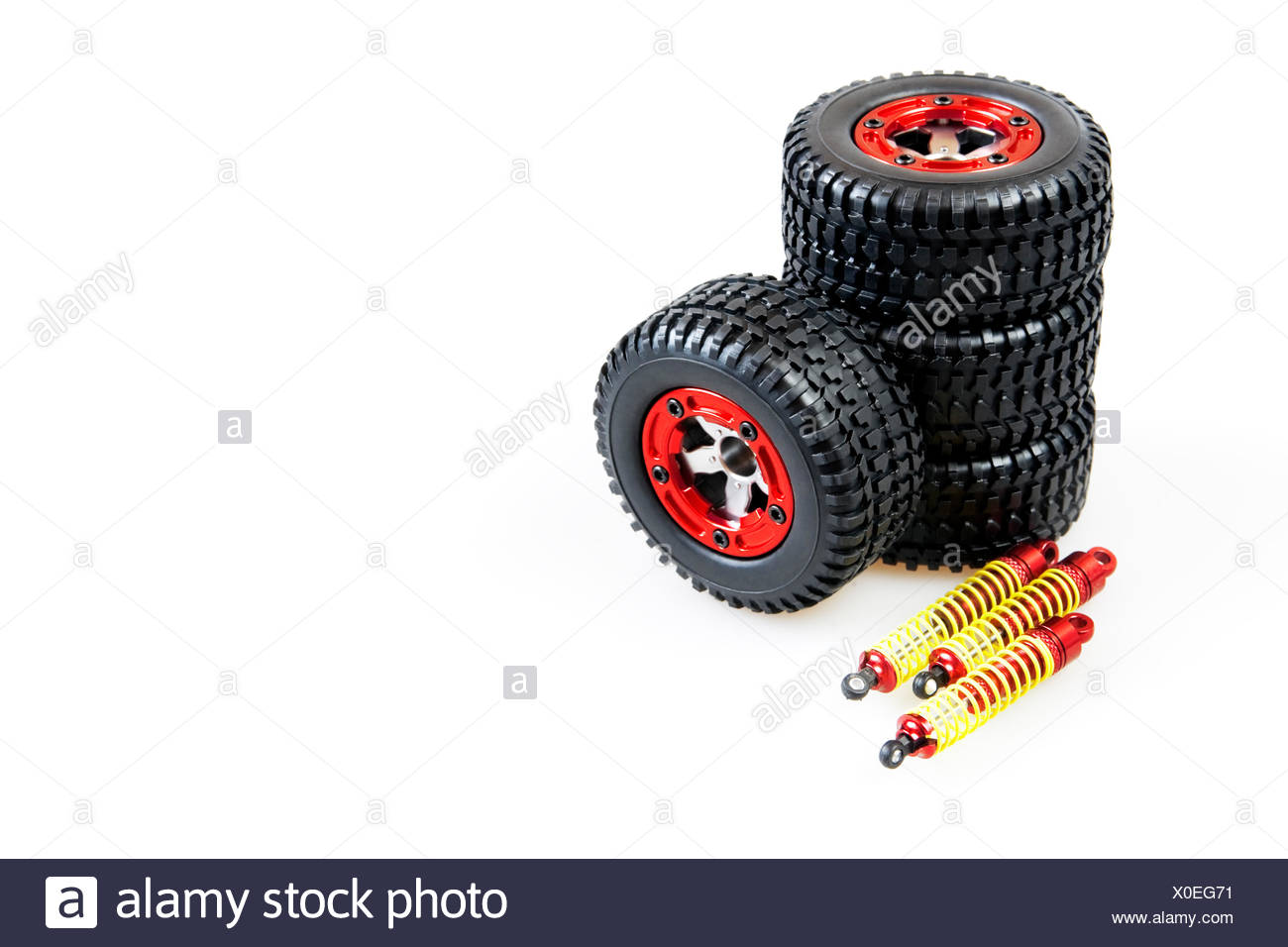 shock-absorbers and wheels of rc car on a white background - Stock Image