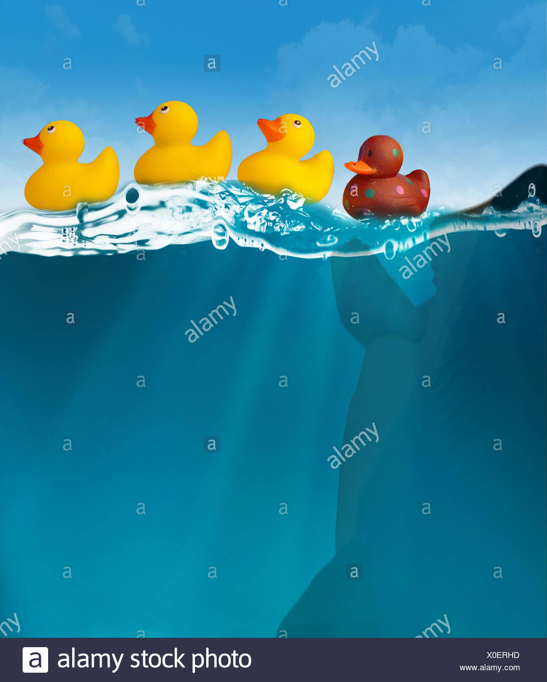Close-Up Side View Of Plastic Ducks In Water - Stock Image
