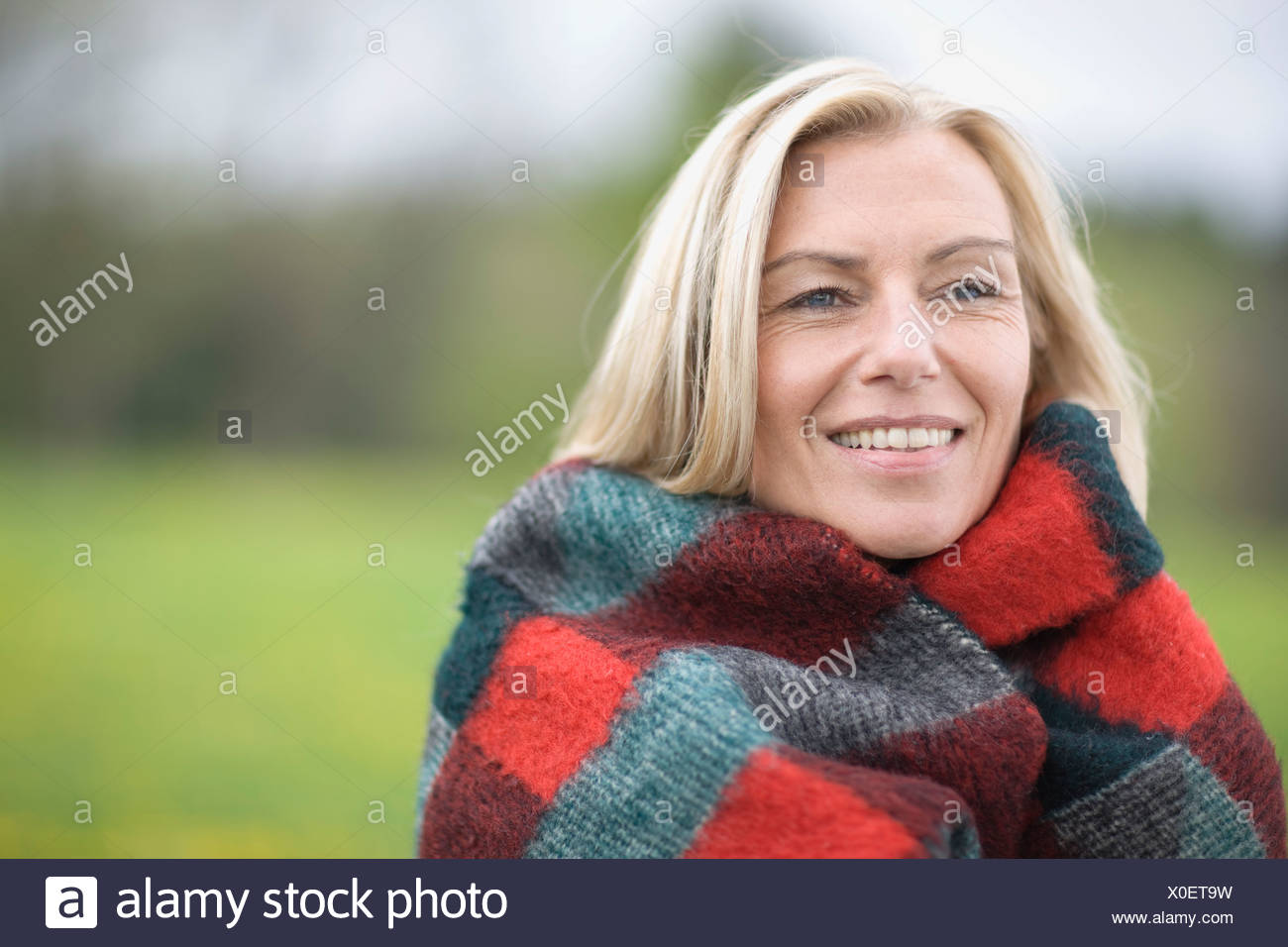 Woman in blanket - Stock Image