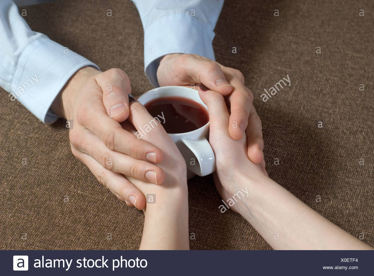 Close Up Of Young Couple Hand S Holding Tea Cup Together Stock Photo Alamy