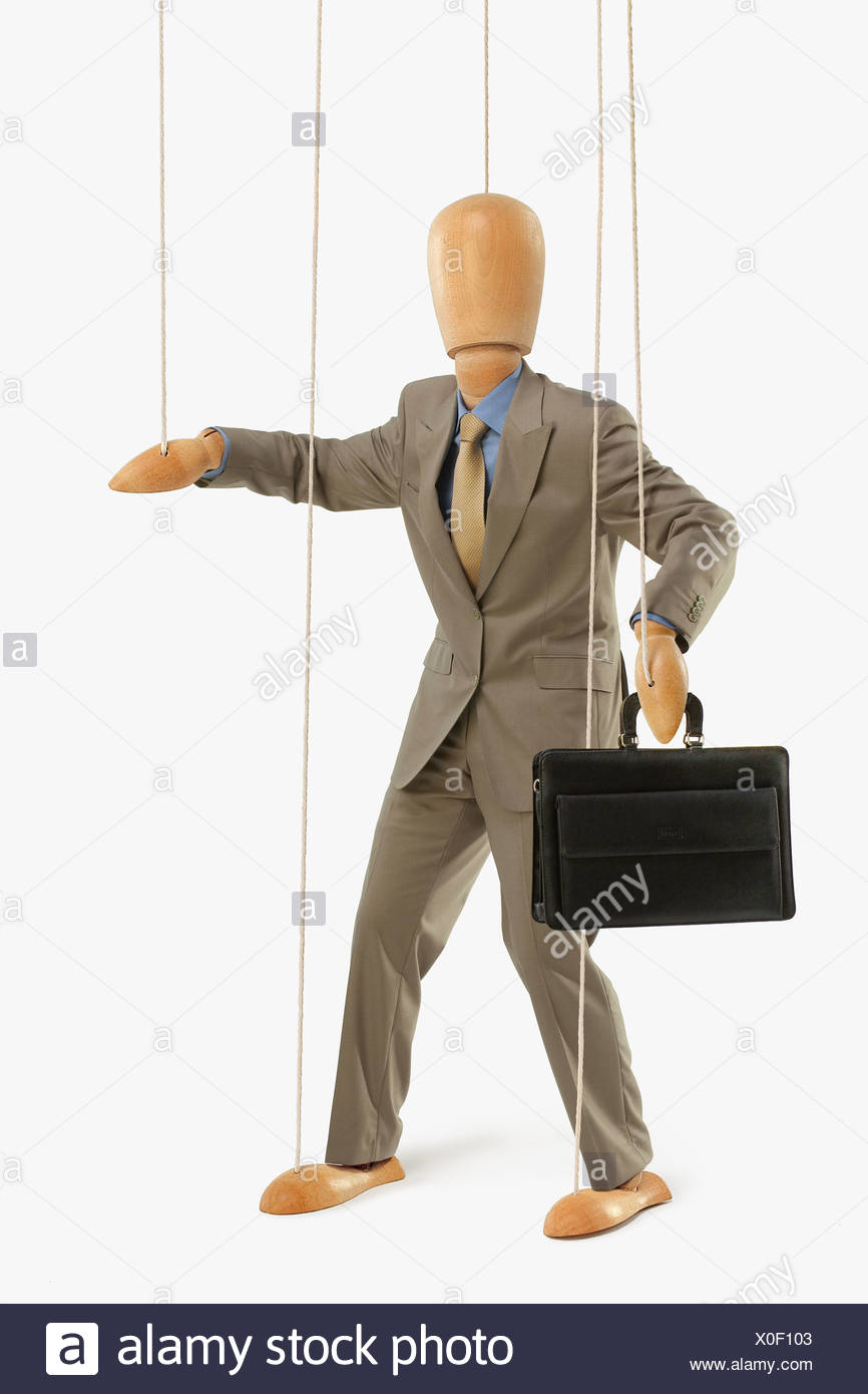 Puppet Dressed As A Businessman Stock Photo