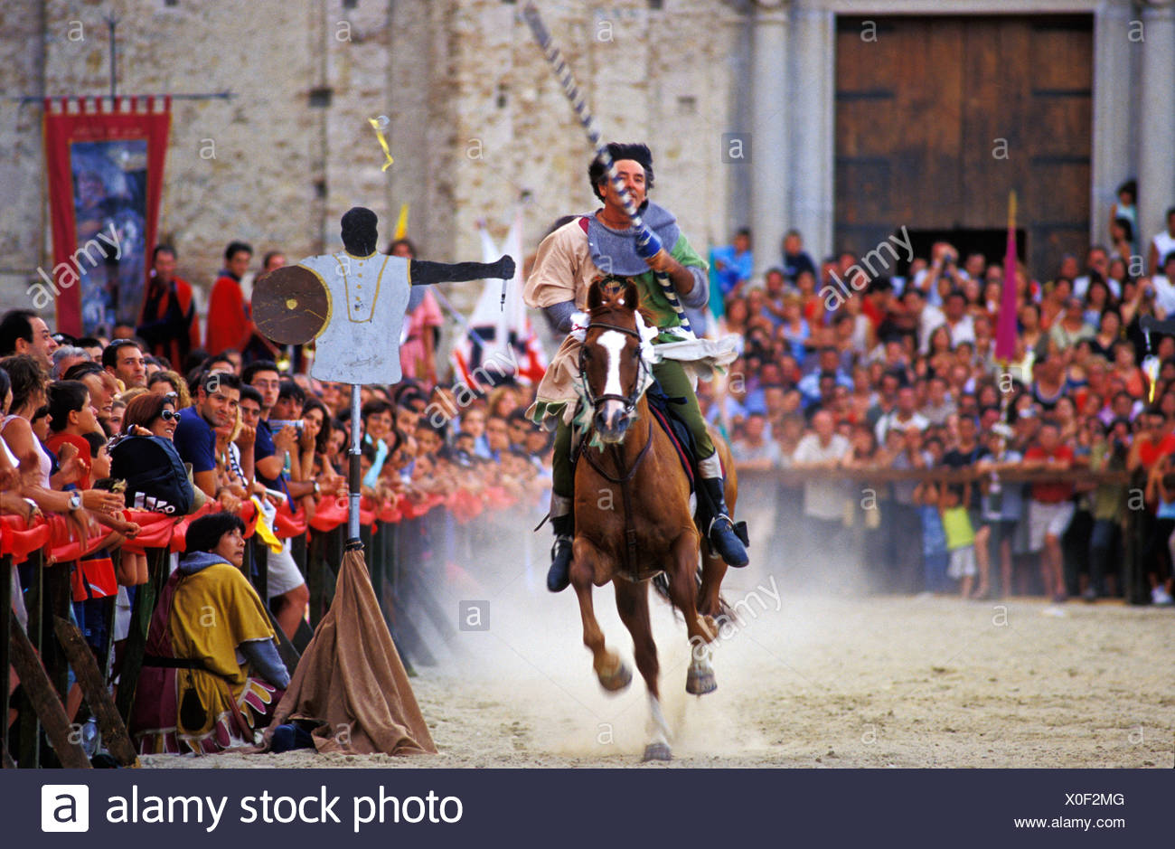 Palio, medieval joust in Stilo, rider tries to spike a little ring, Calabria, Italy - Stock Image