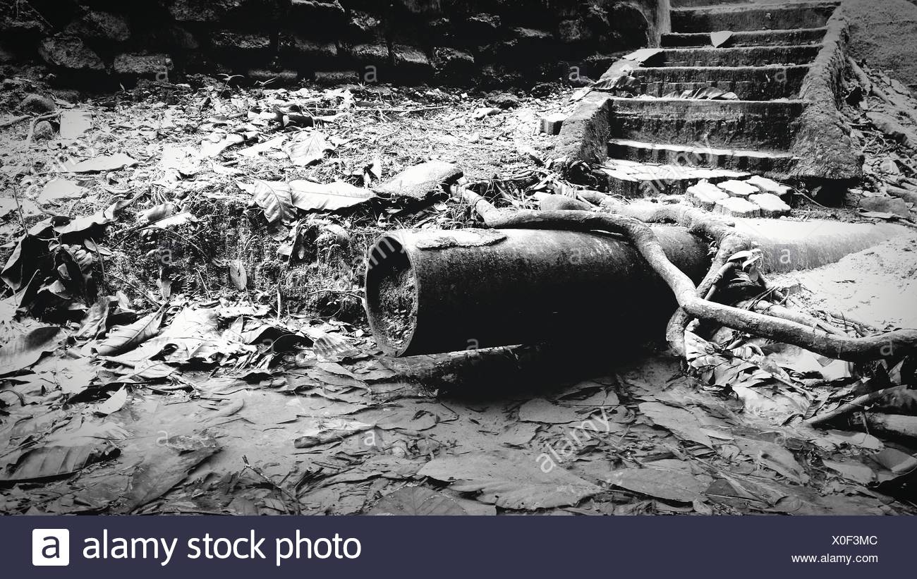 High Angel View Of Pipe On Messy Field - Stock Image
