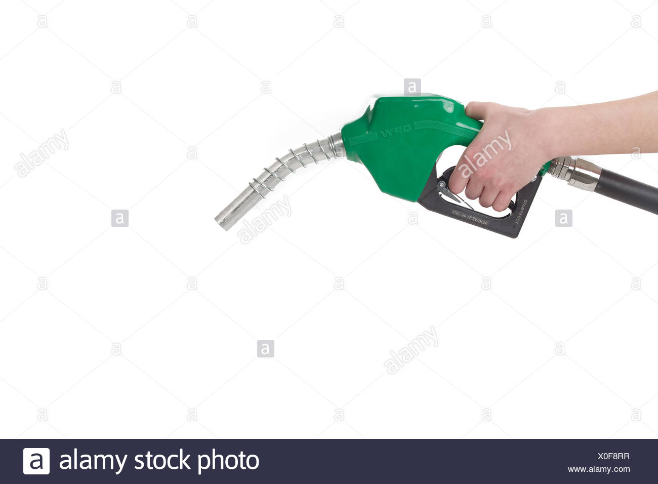 A hand with a gasoline nozzle, Winnipeg, Manitoba - Stock Image