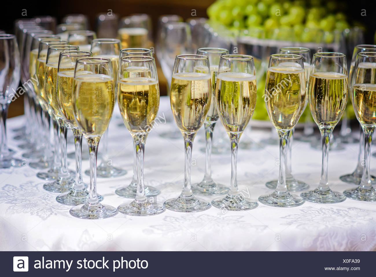 Glasses of champagne waiting for guests - Stock Image