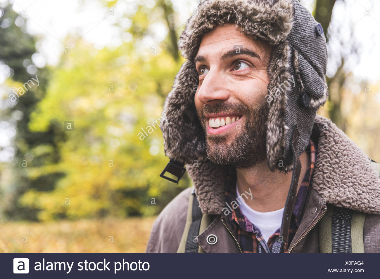 Mid Adult Man Wearing Trapper Hat Stock Photos   Mid Adult Man ... 750108d91a56