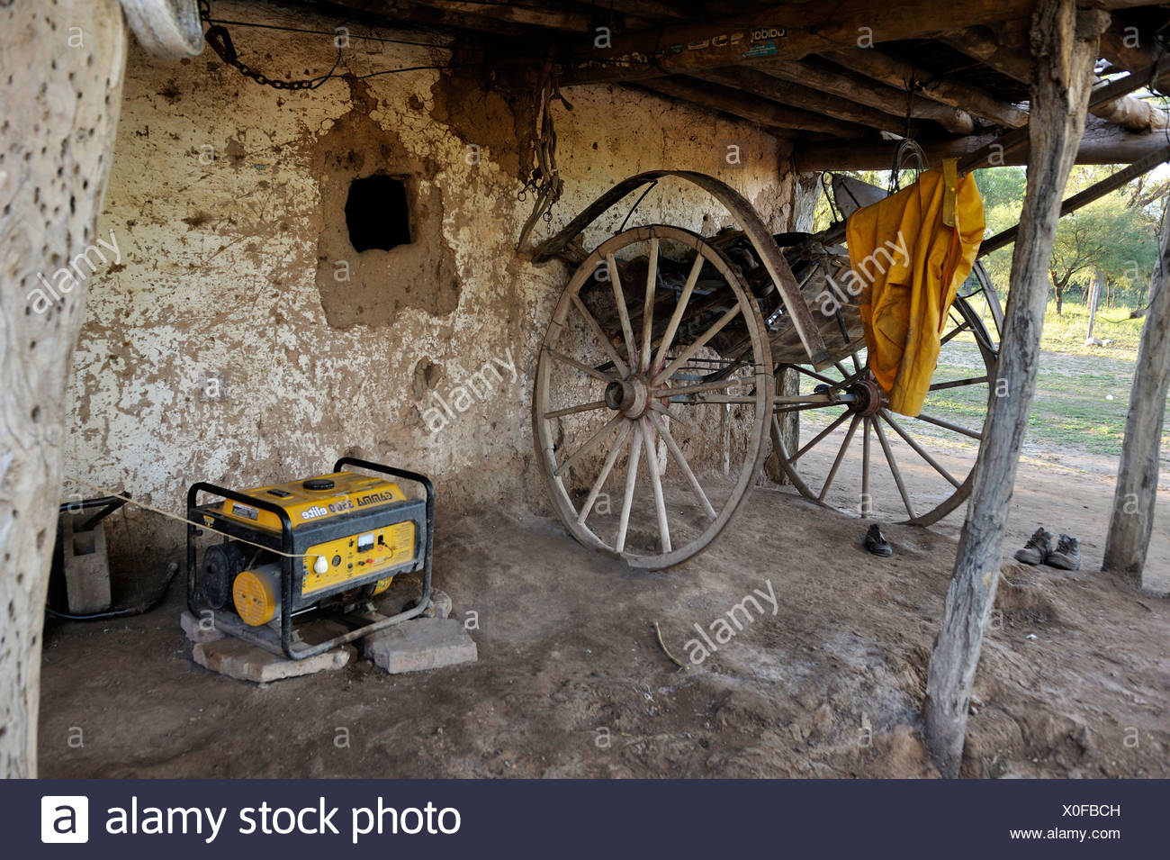 Generator and ox-cart on a small farm, Gran Chaco, Santiago del Estero Province, Argentina, South America - Stock Image