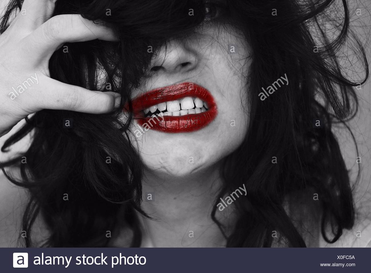 Close-Up Angry Woman With Hand In Hair - Stock Image