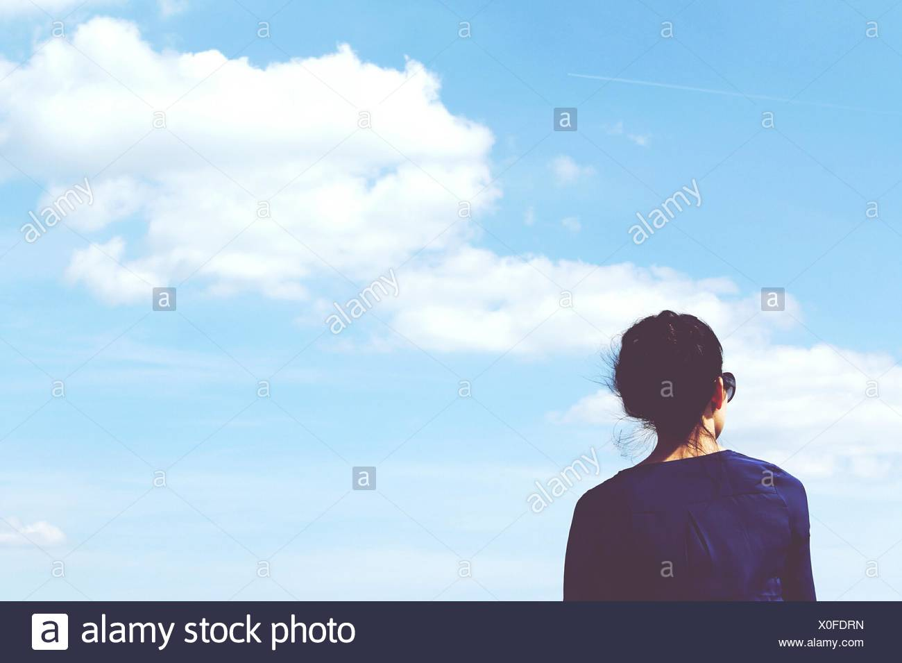 Rear View Of Woman Against Sky - Stock Image