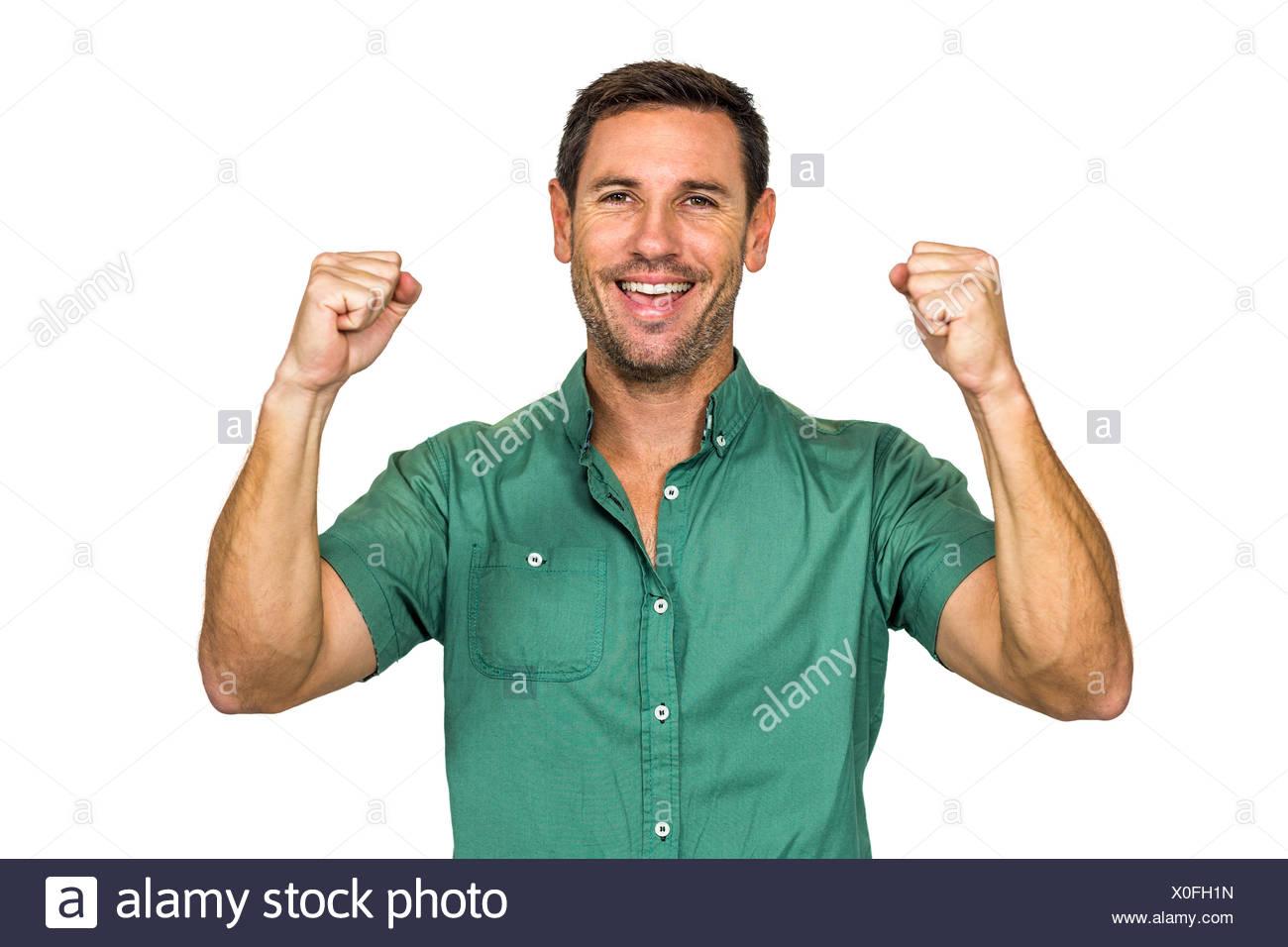 Happy man rejoicing raising fists - Stock Image