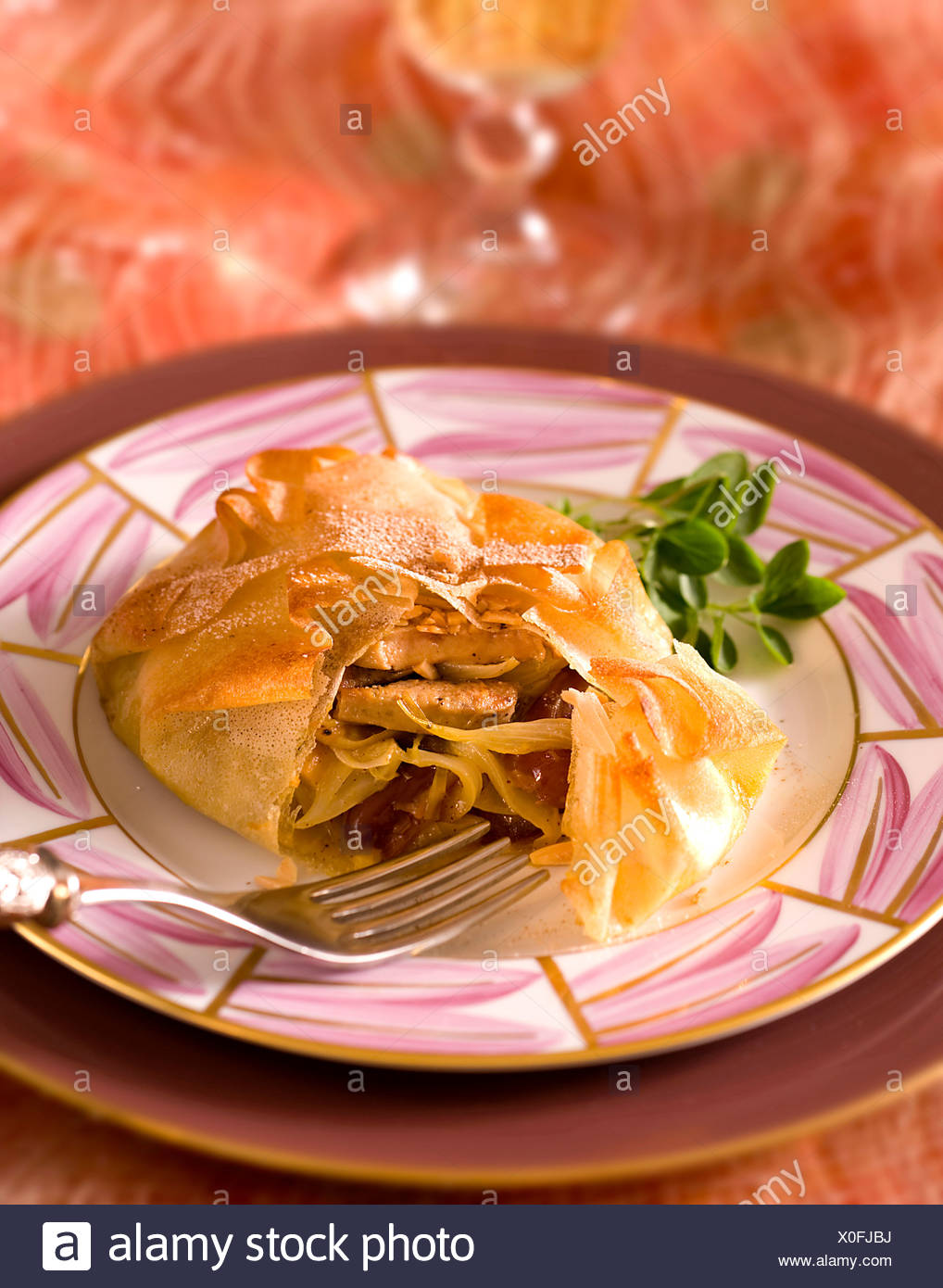Stuffed Pastilla Pie with Onions and Dates - Stock Image
