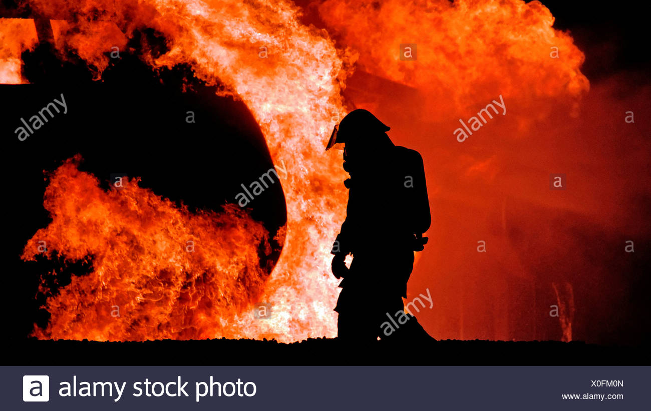 Firefighter and Flames - Stock Image