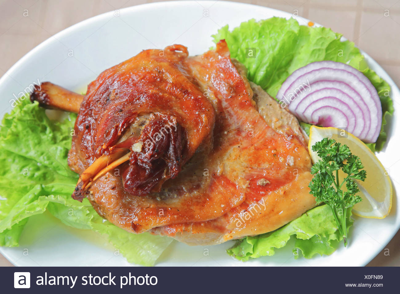 Roasted Lamb Shank - Stock Image