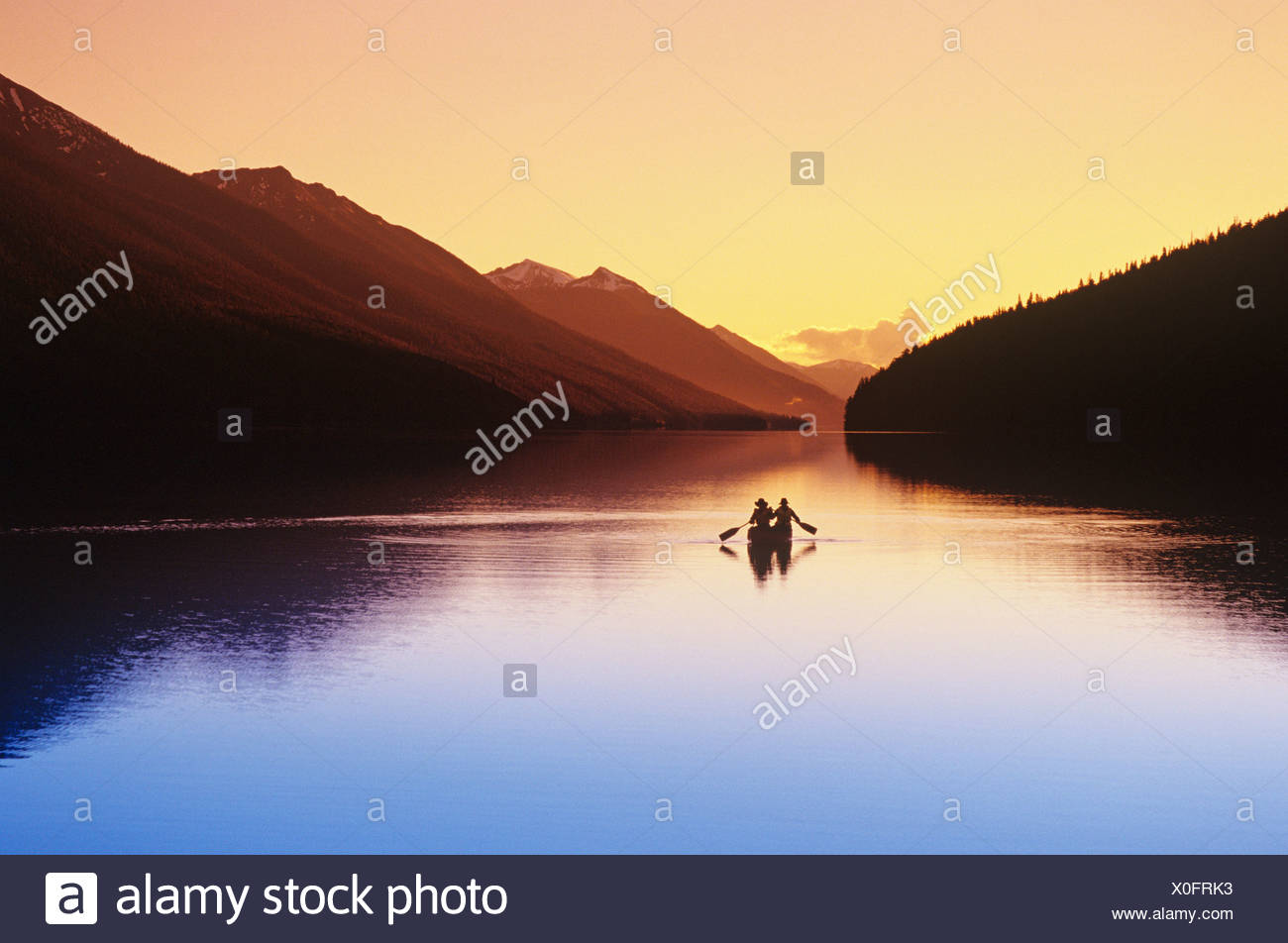 Canoeist on Isaac lake, Bowron Lake Provincial Park, British Columbia, Canada. - Stock Image