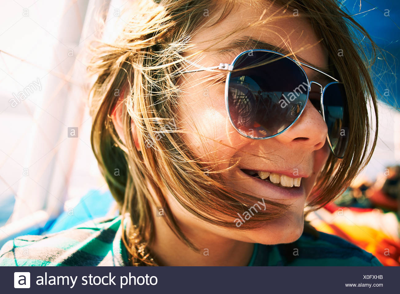 Close up candid portrait of boy in sunglasses Stock Photo