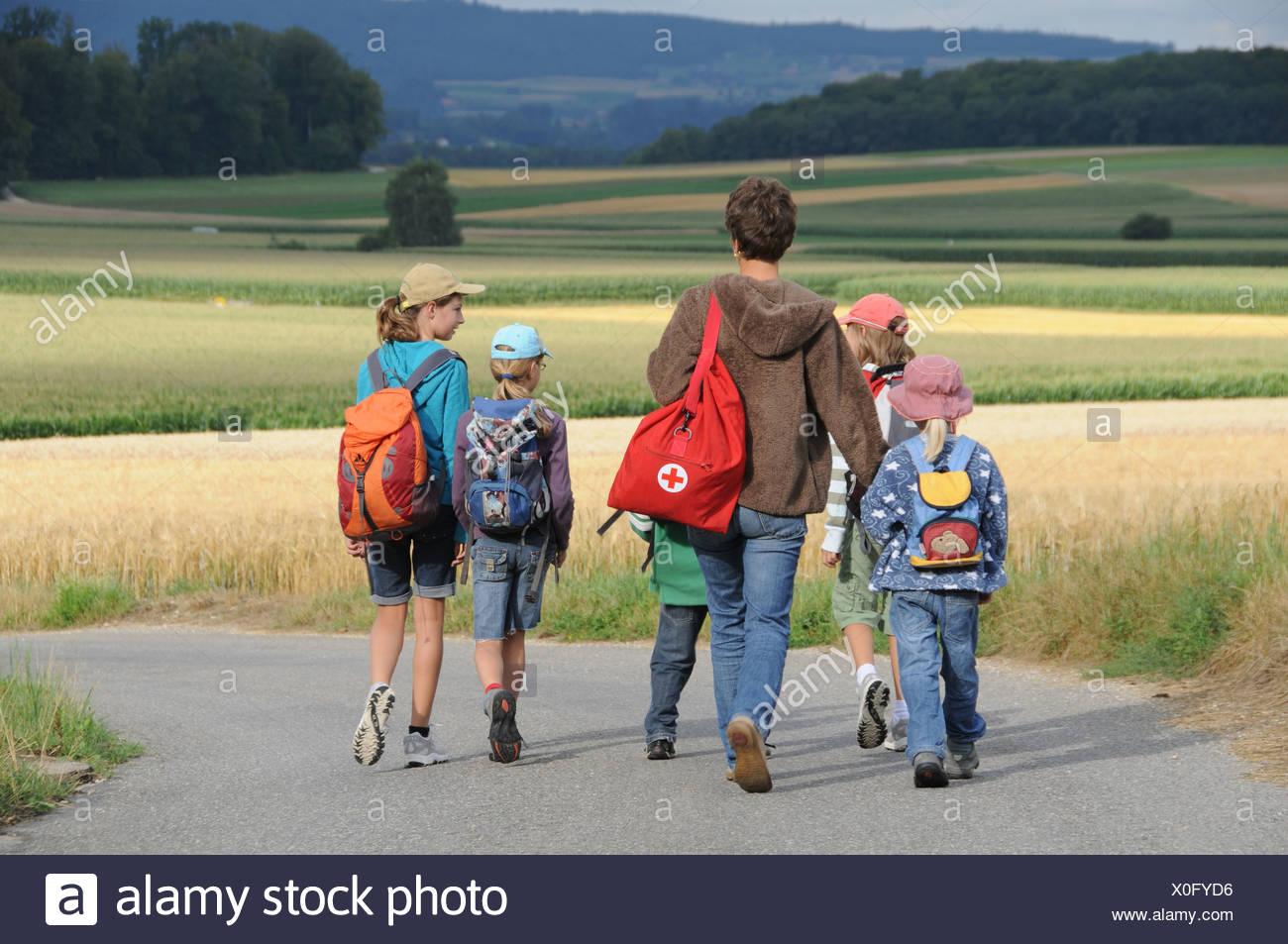 Pupil, school, trip, hikin, walking, fields, way, excursion, Switzerland - Stock Image