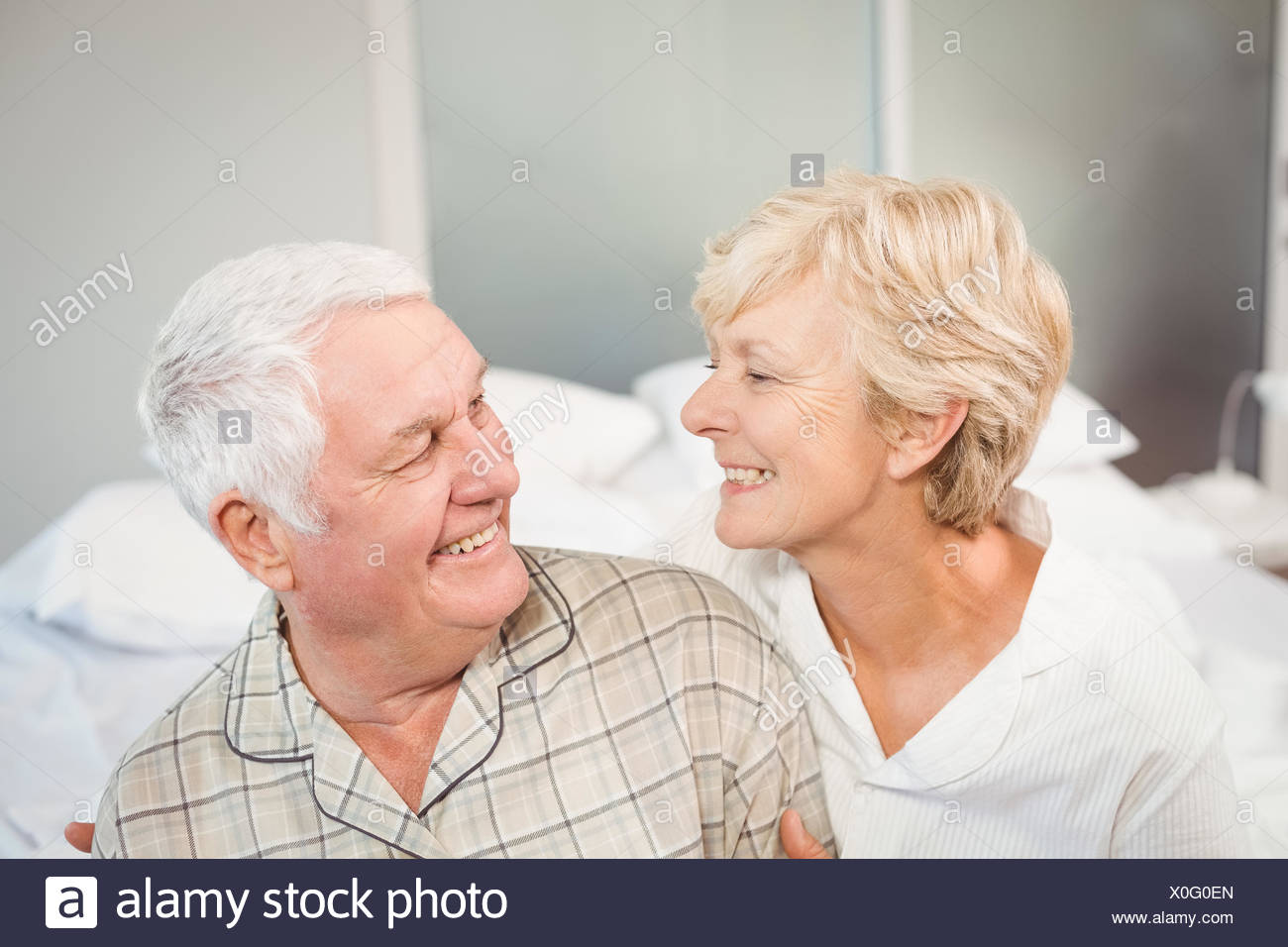 High angle view of happy senior couple in nightwear - Stock Image