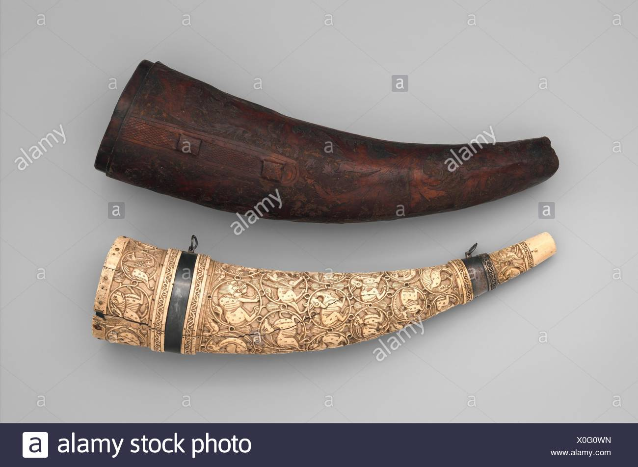 Horn (Oliphant) with Case. Date: horn, 11th-12th century; case, 16th century; Culture: South Italian; Medium: Ivory, silver, leather; Dimensions: Stock Photo