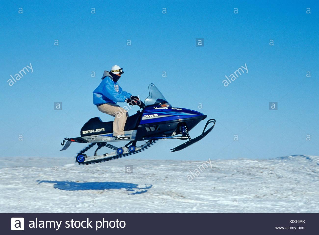 Inuit on his snowmobile, USA, Alaska - Stock Image