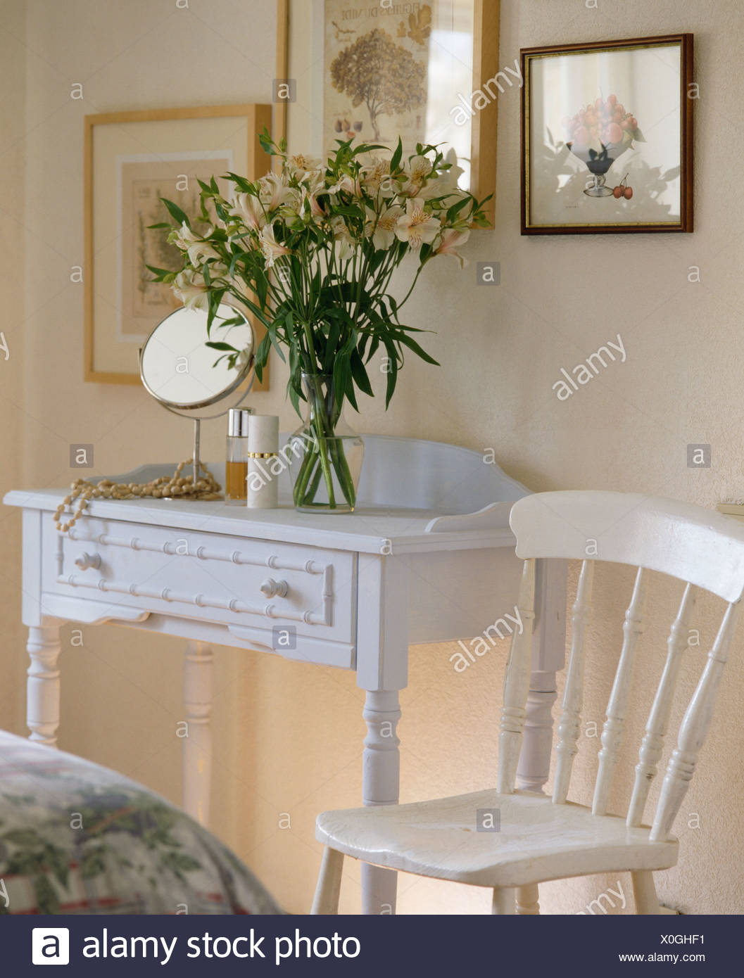Painted dressing table stock photos painted dressing table stock close up of white chair beside matching table with vase of cream alstromerias in french reviewsmspy