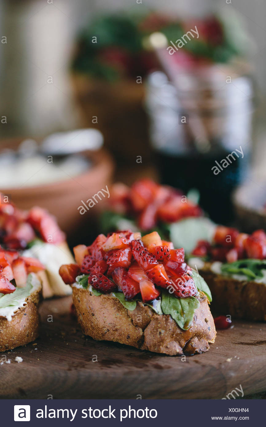 Strawberry and Ricotta Bruschetta with Balsamic Reduction - Stock Image