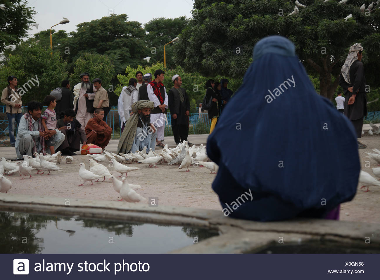 People in the park of the Blue Mosque in Mazar-e Sharif, Balkh, Afghanistan, Asia - Stock Image