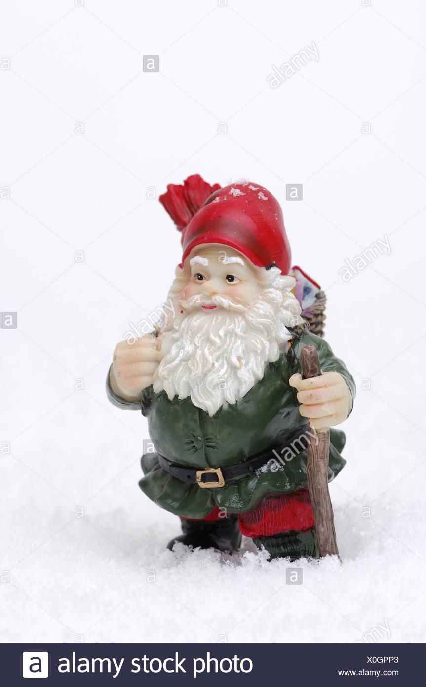 artificial snow Santa Claus-figure Christmas-decoration decoration-object figure Santa Claus traveling-stick decoration - Stock Image