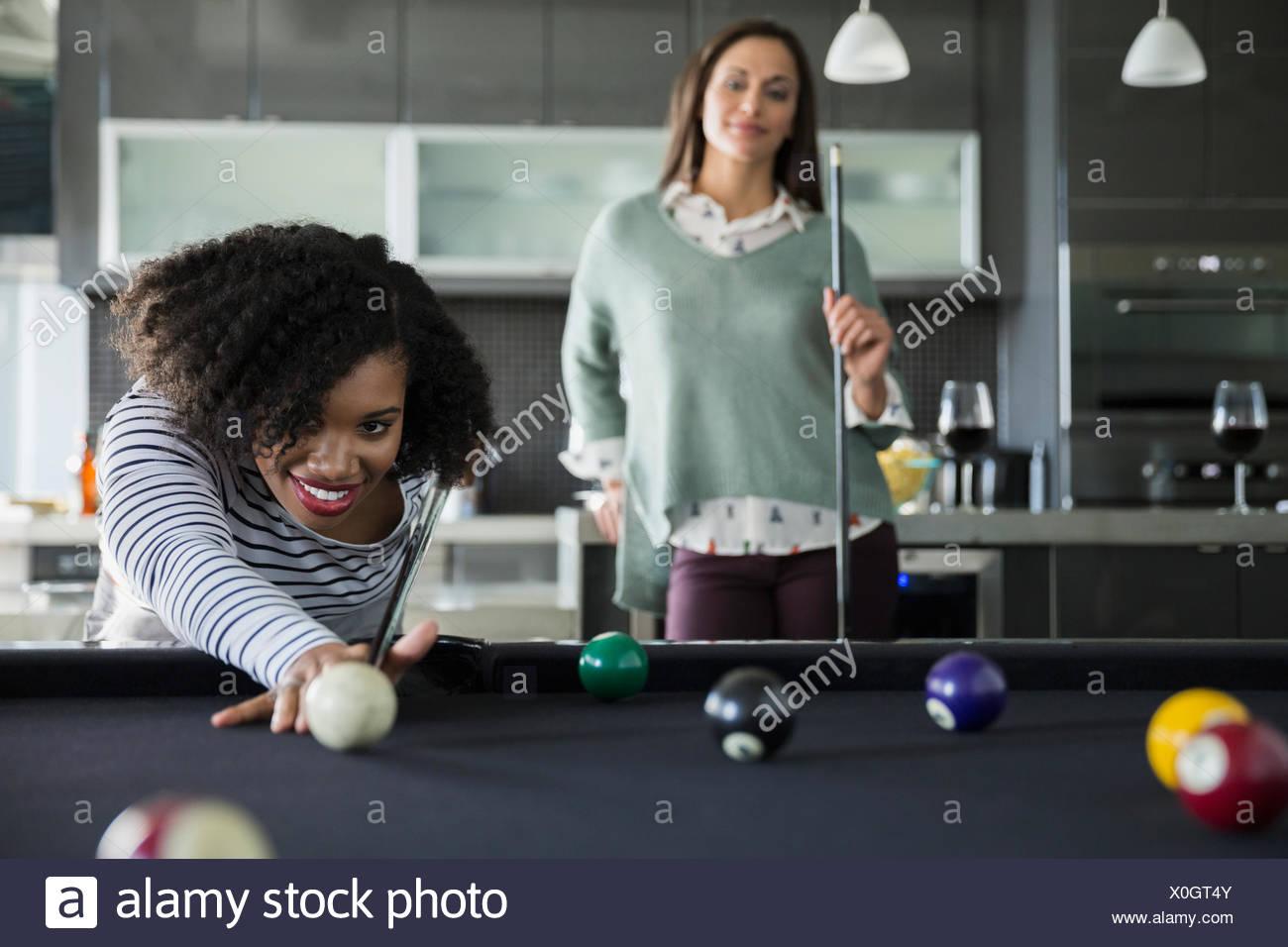 Women playing pool - Stock Image