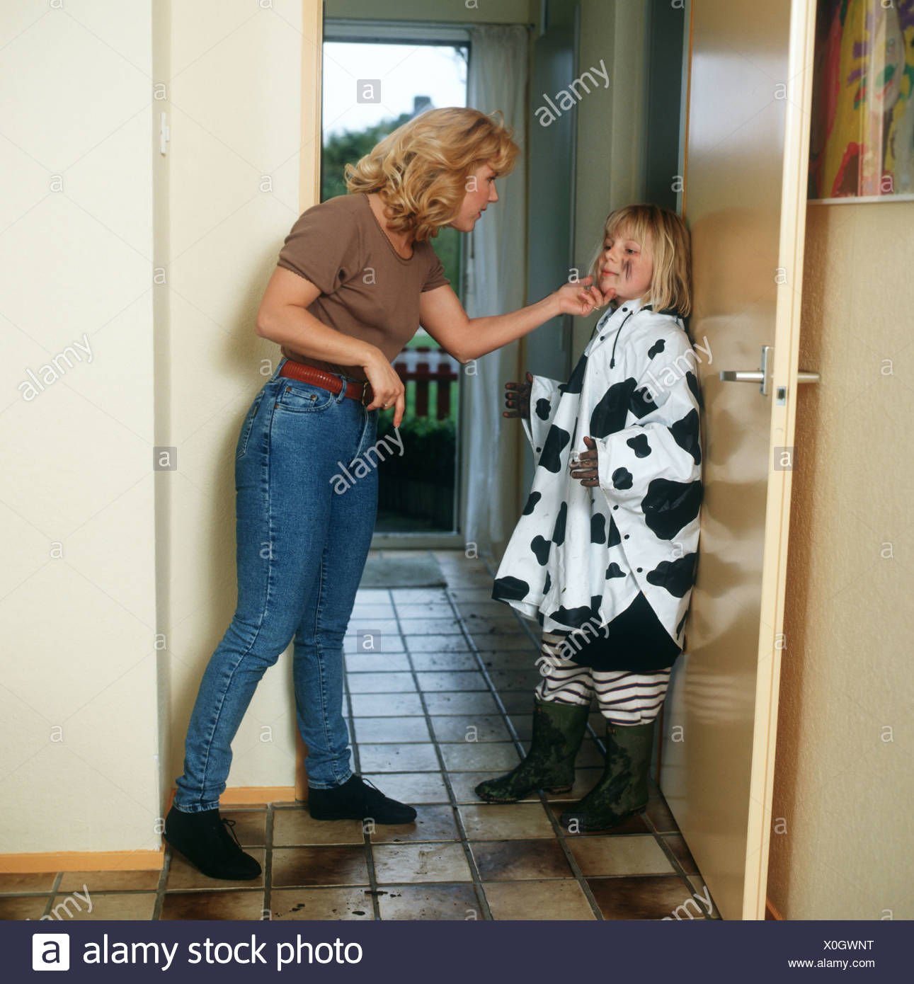 Stressed mother and child being told off Stock Photo