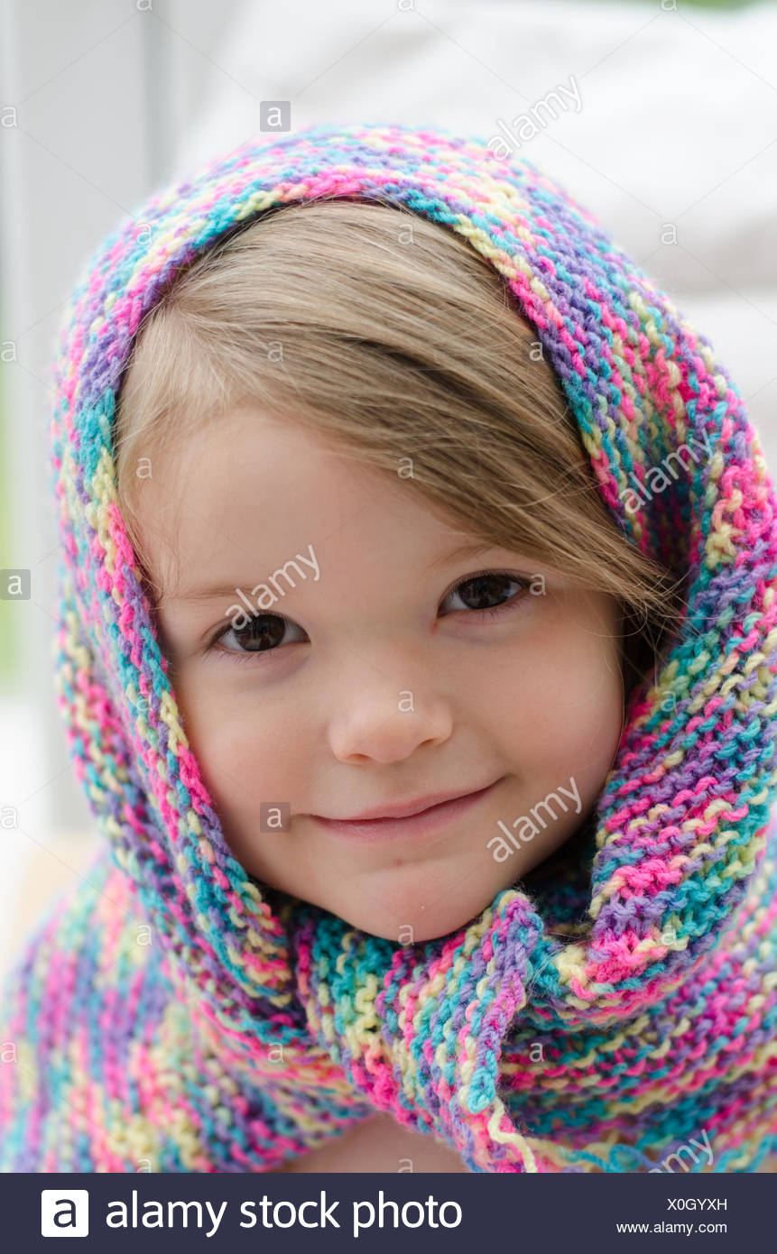 Portrait of a girl in colorful scarf - Stock Image