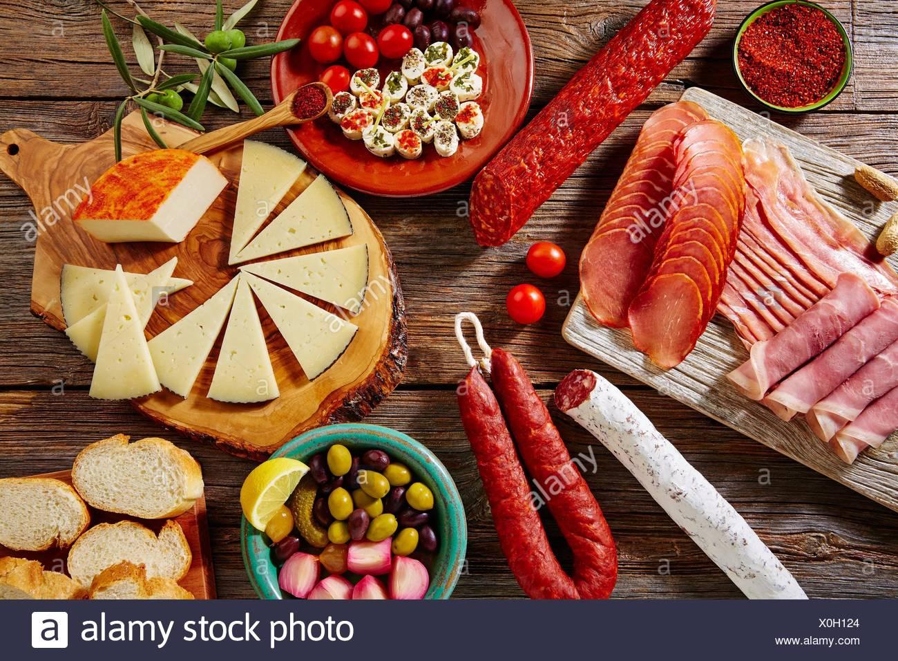 Tapas sausage mix from Spain jamon iberico lomo cheese ham chorizo olives. - Stock Image
