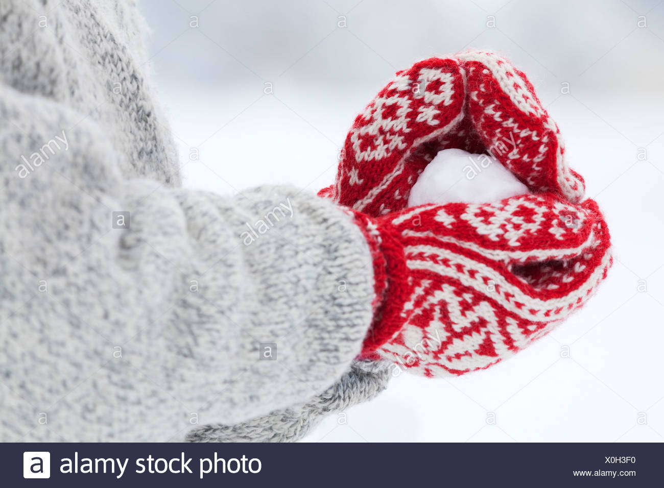 Person making snowball - Stock Image
