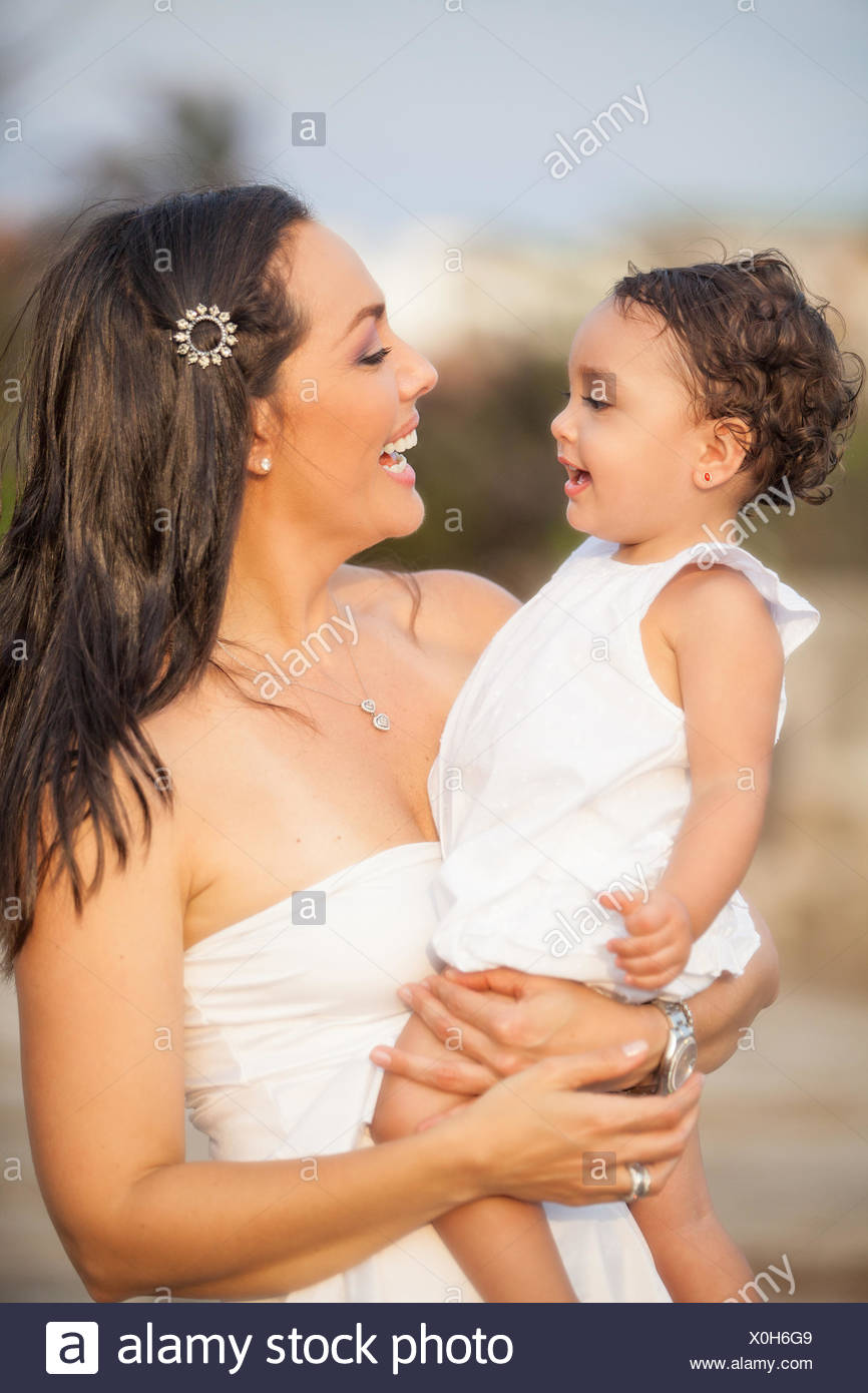 3a33d195c80 Mother and her baby girl dressed in white Stock Photo  275744233 - Alamy