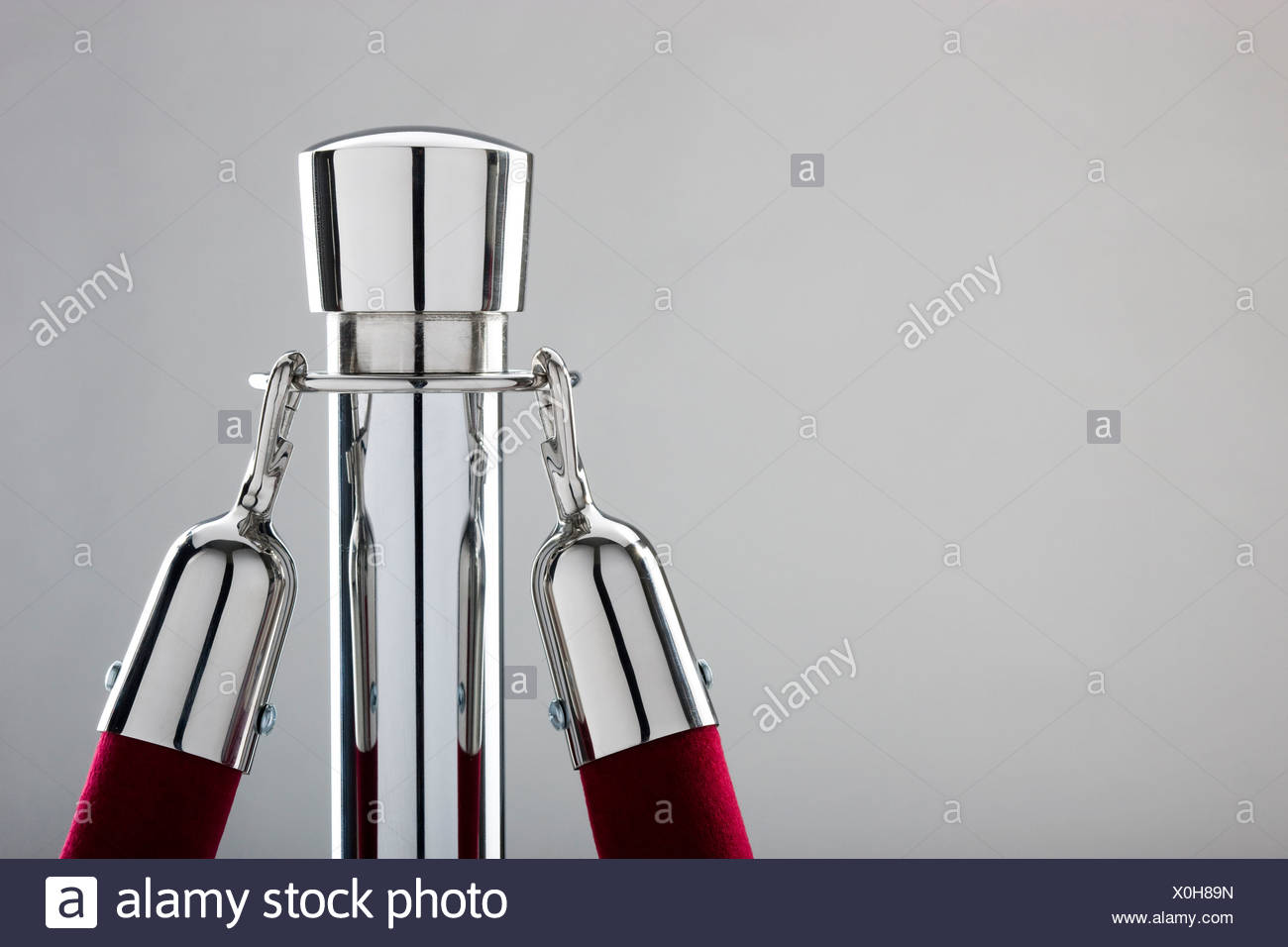 rope stand with a velvet rope attached - Stock Image