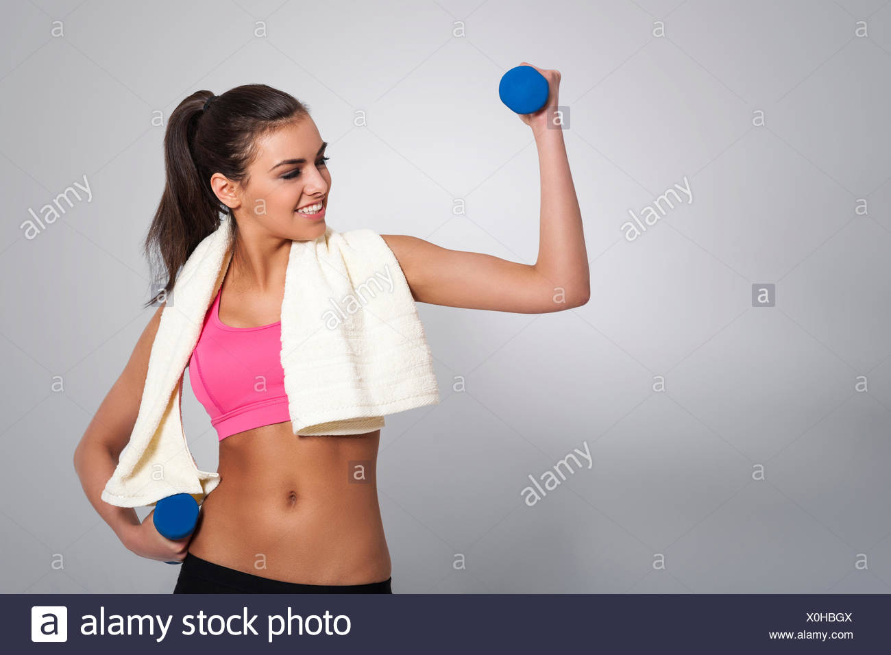 Attractive woman working hard to stay fit. Debica, Poland - Stock Image