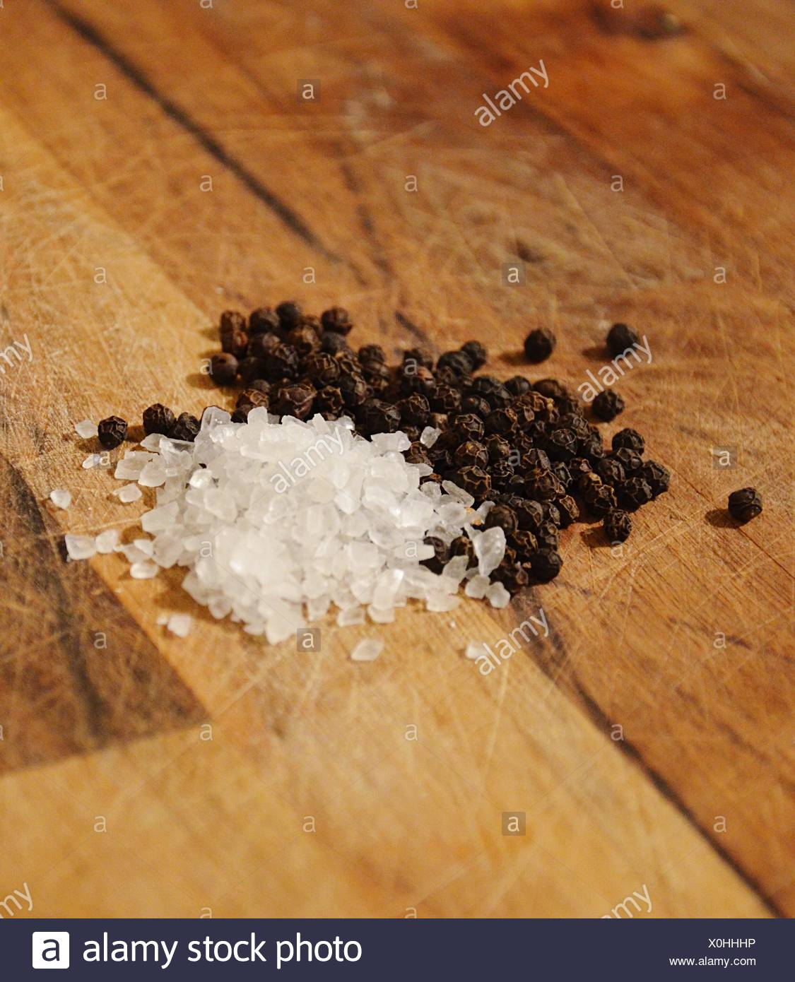 High Angle View Of Black Peppers And Sugars On Table - Stock Image