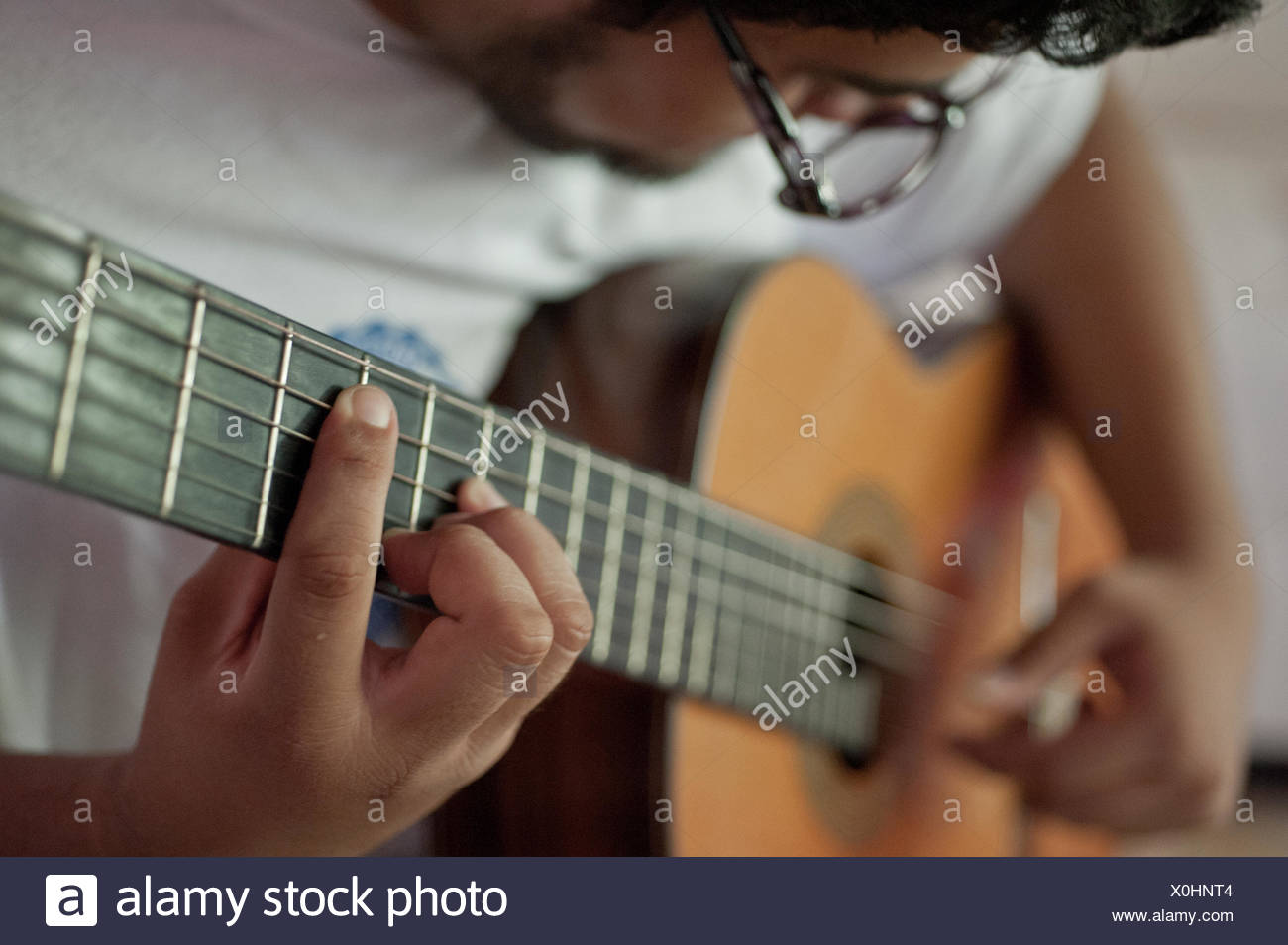 A man plays a flamenco guitar. - Stock Image