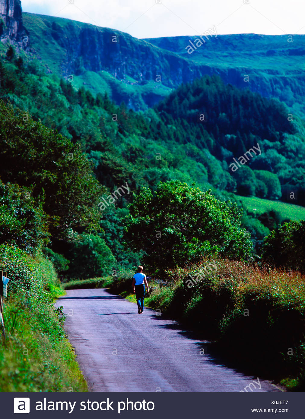 Rear View Of A Person Walking On Road Stock Photo