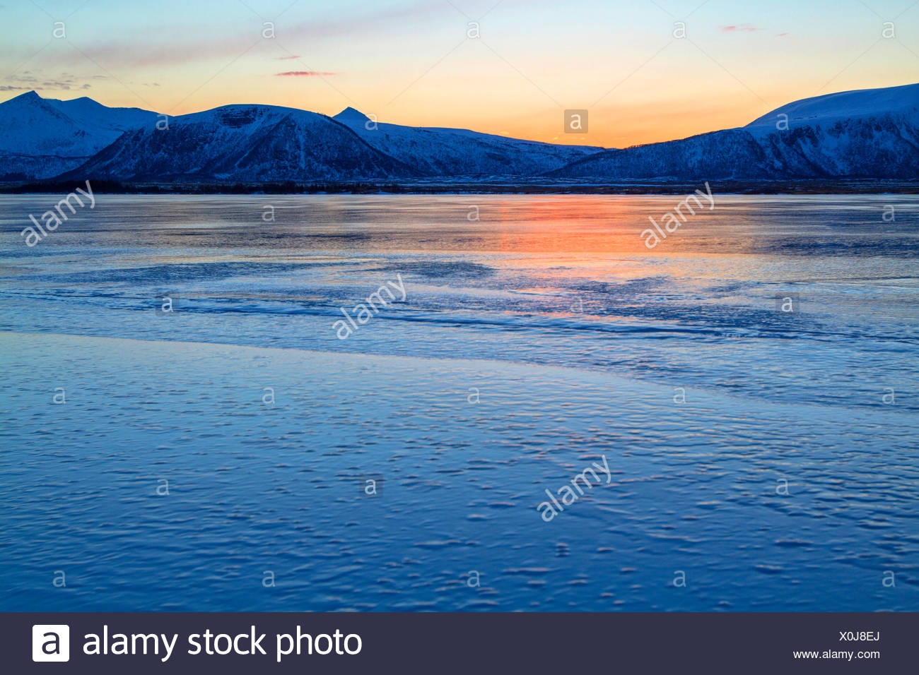 shine of the midnight sun mirroring on a frozen lake, Norway, Vester�len, Insel And�ya, Andenes - Stock Image