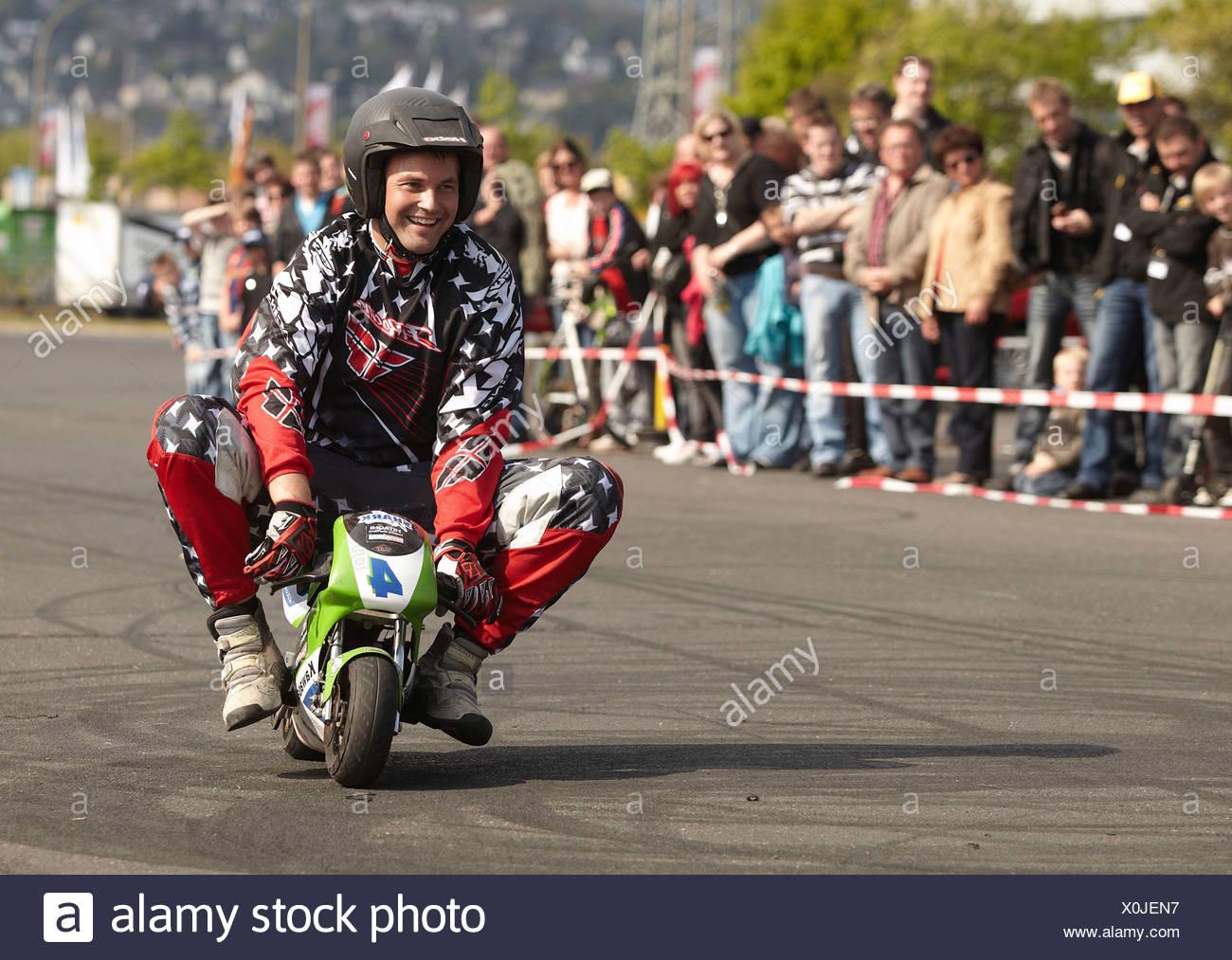 Motorcycle stuntman Mike Auffenberg riding a pocket bike, Koblenz, Rhineland-Palatinate - Stock Image