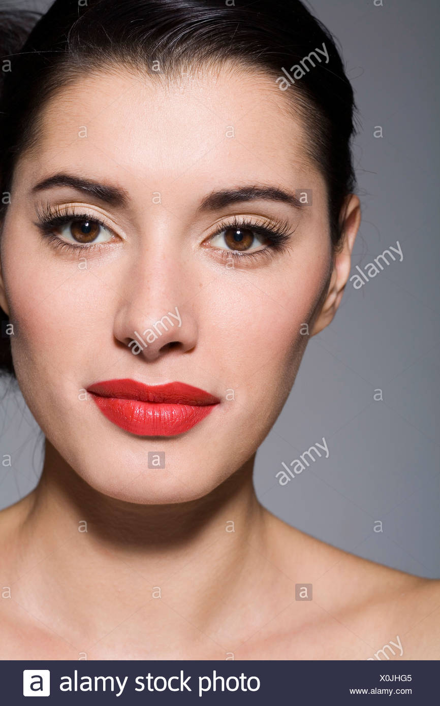 a6b48bdcf67 Female wearing glamorous make up with long false eyelashes, black eyeliner  in a flick and bright red lipstick