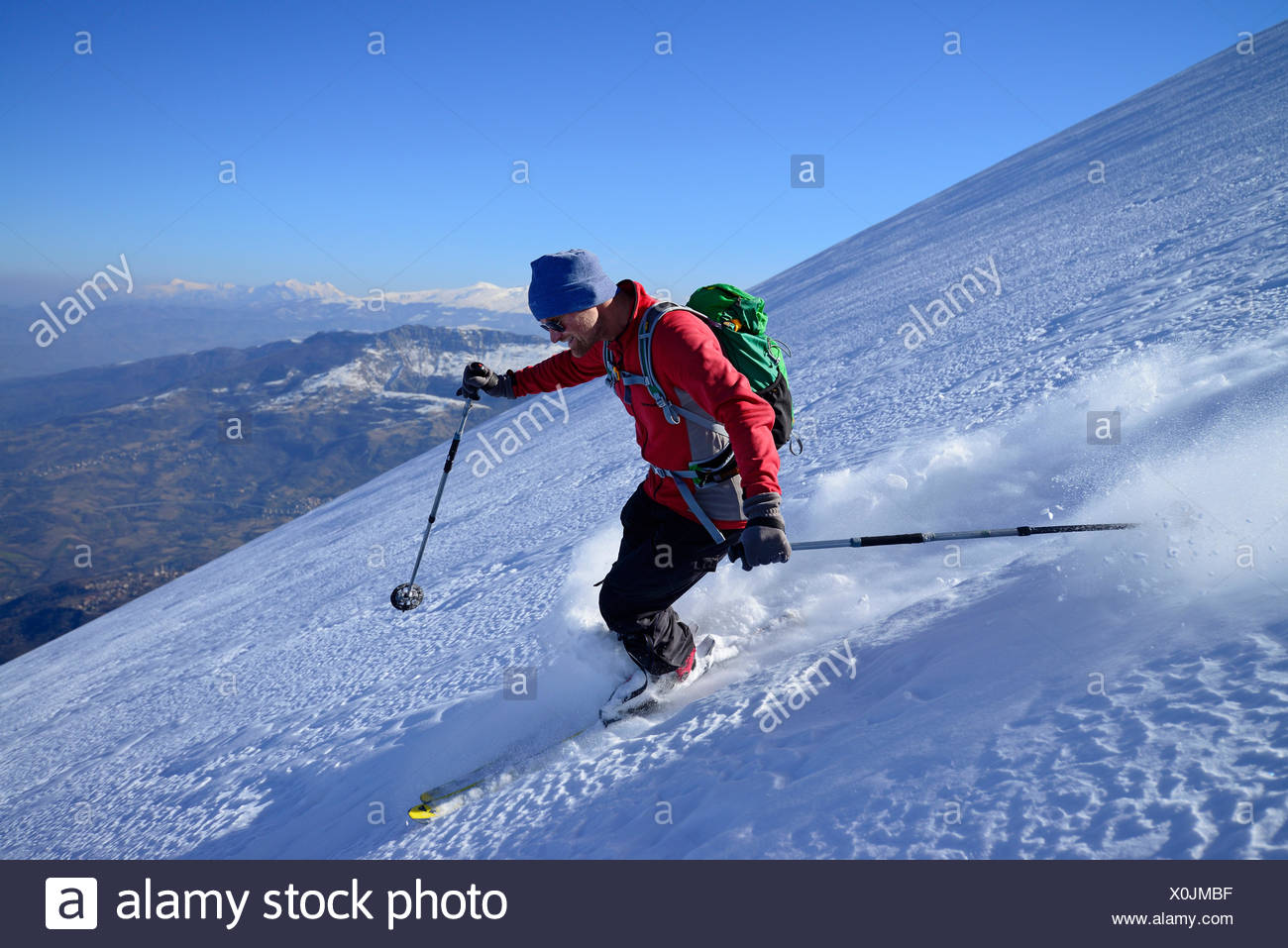 Backcountry skier downhill skiing, Monte Prena, Gran Sasso, Abruzzo, Italy - Stock Image
