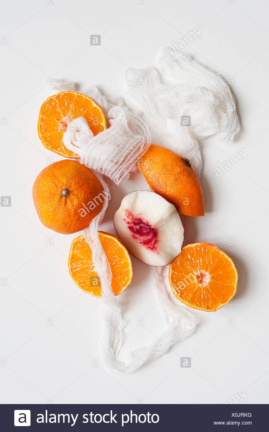 Orange fruit and twine - Stock Image